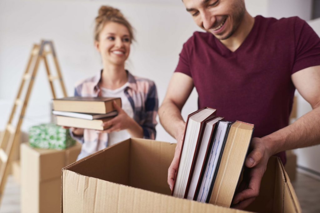 Man and woman packing publications in the package