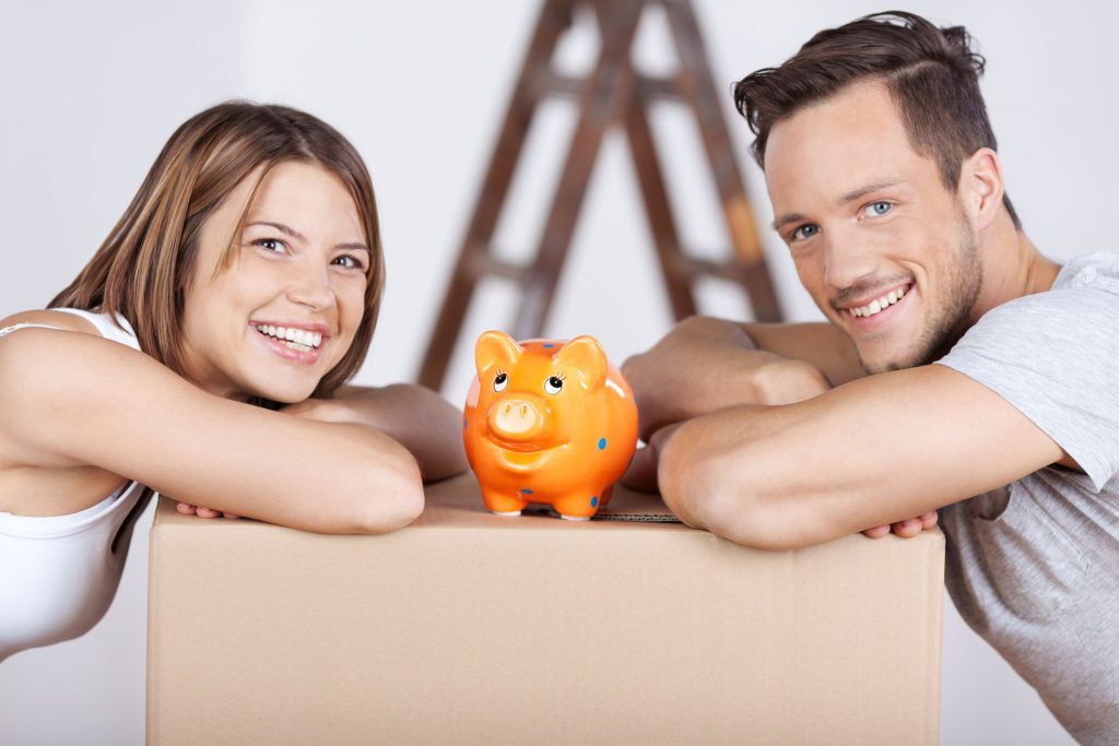 A happy couple and their piggy bank