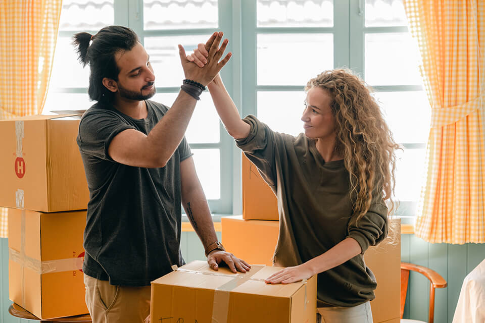 A couple is happy about hiring a moving company in Chicago to assist them