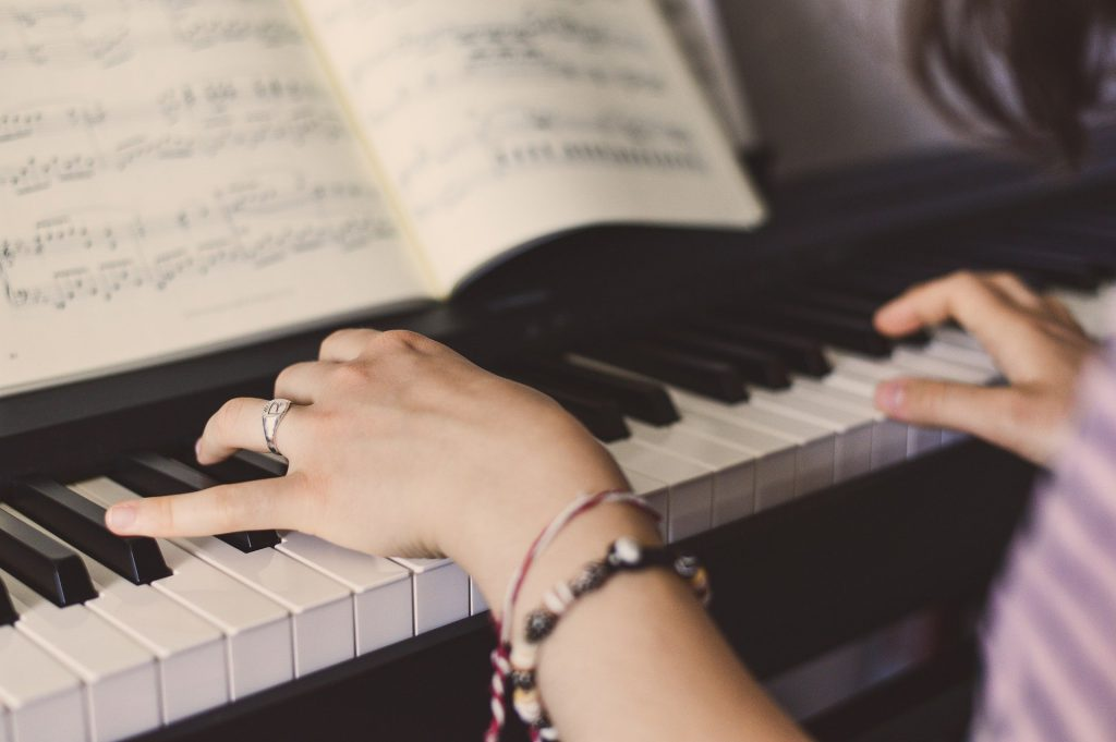 Close view of the woman playing a keyboard
