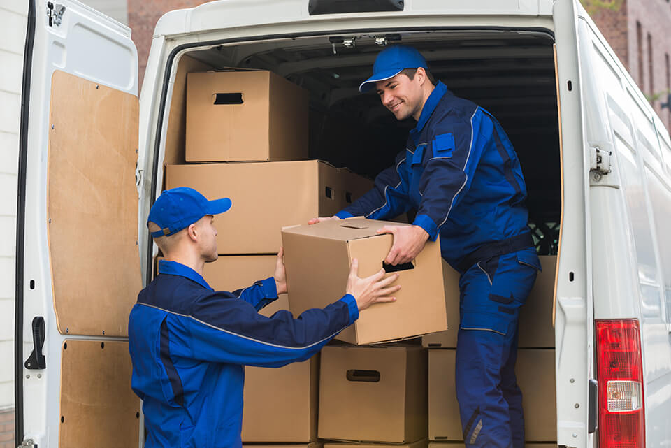 Two local movers in Chicago loading a truck