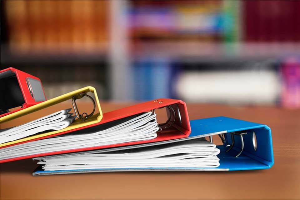 Yellow, red, and blue binder on the desk