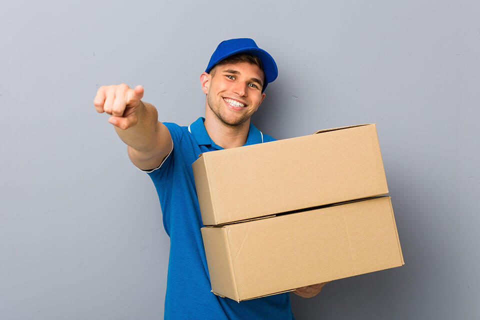 One of the professional movers in Chicago holding a box