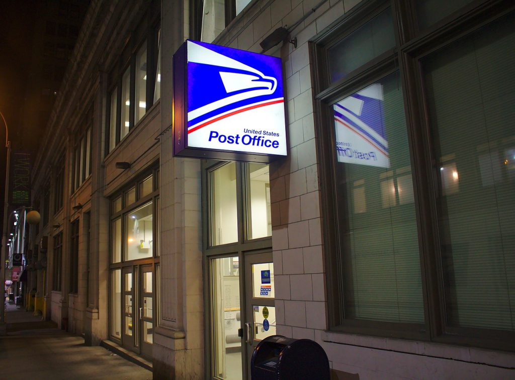 A USPS office, pictured at night