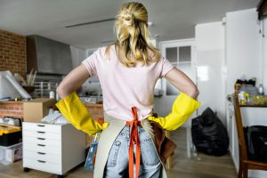 Woman ready to wash every part of the kitchen