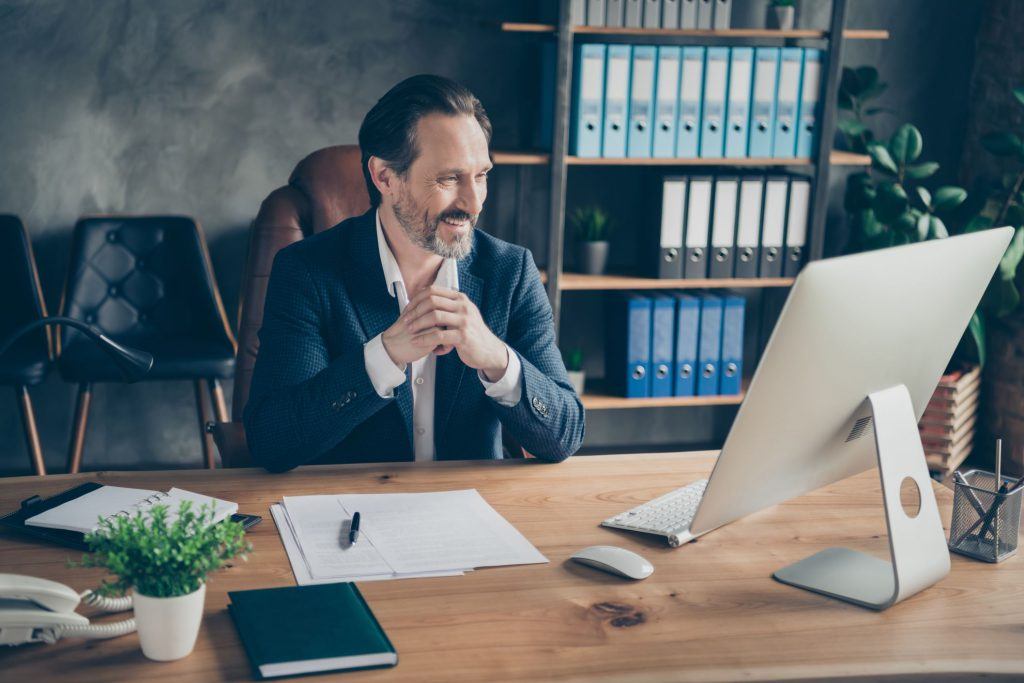 Guy in a better office as one of the benefits of moving