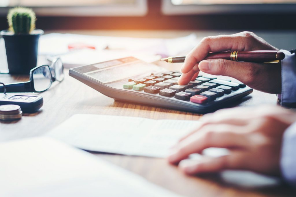Person calculating expenses and thinking about benefits of moving