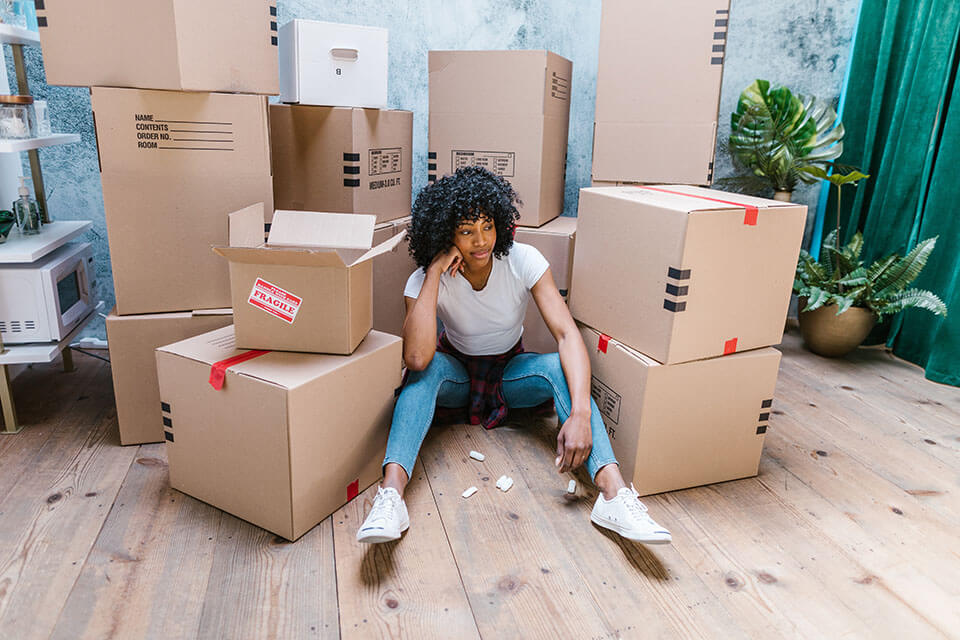 A girl about to unpack boxes local movers in Chicago left