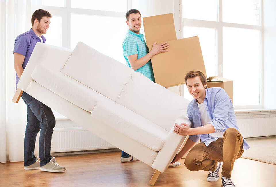 Two men lifting a couch without the help of Chicago movers