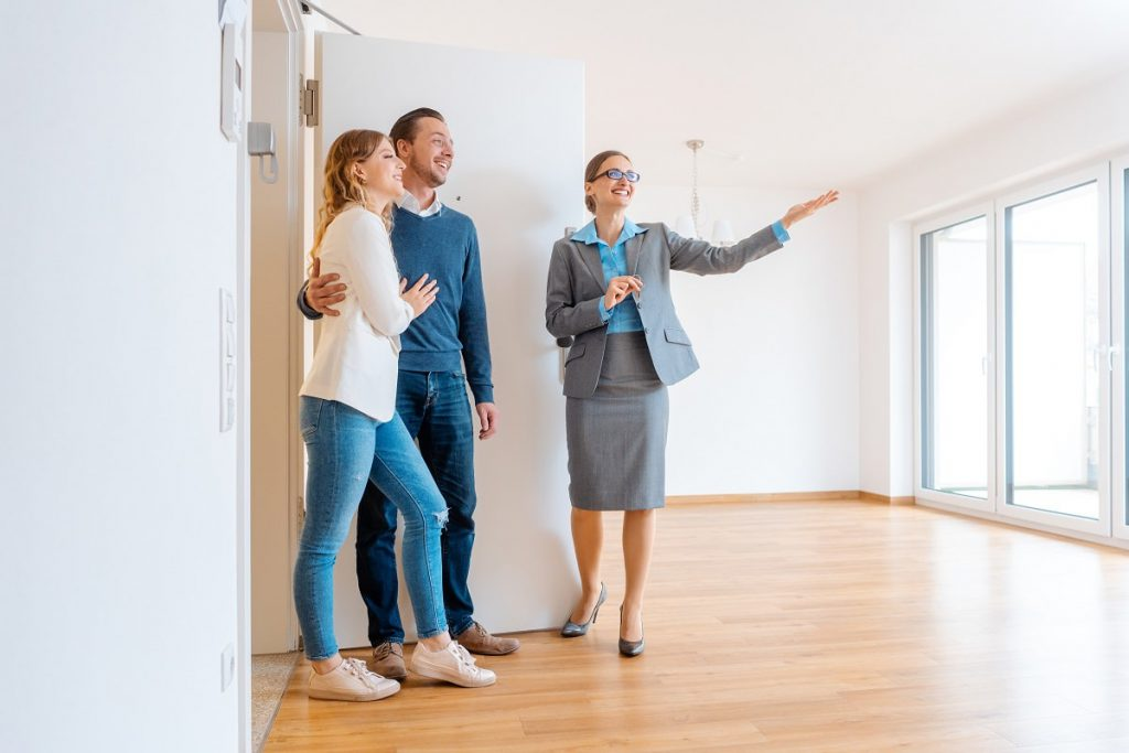 Couple choosing apartment with a real estate agent