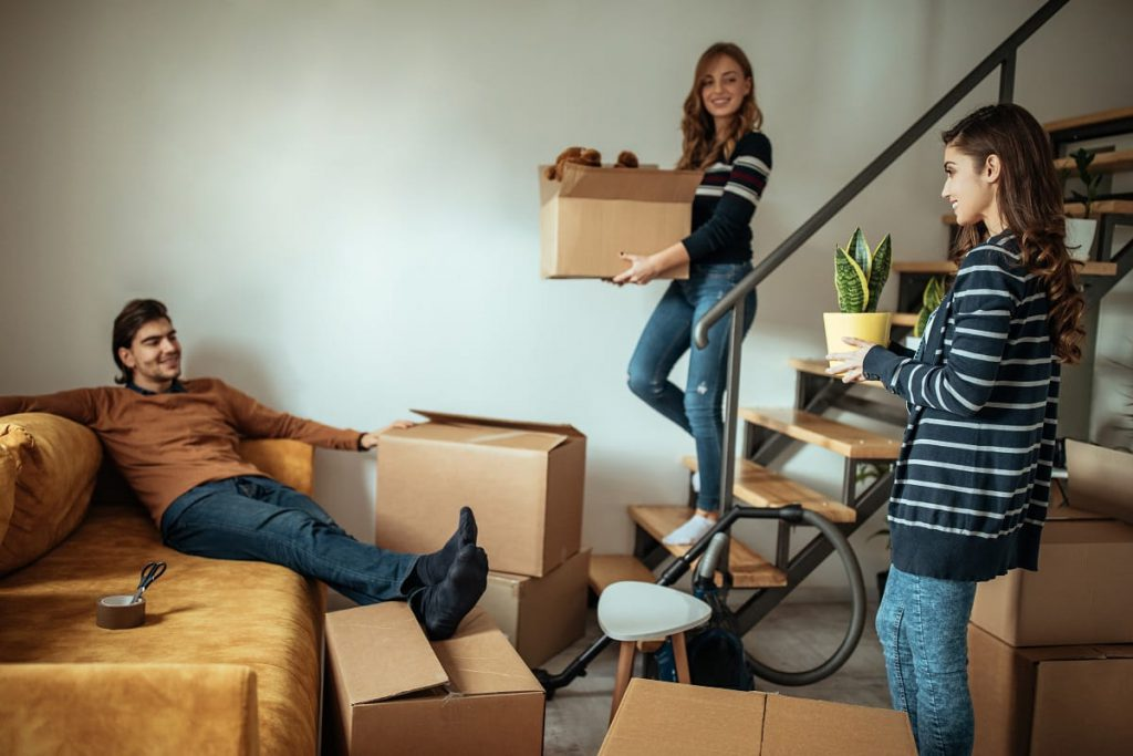 People unpacking after relocating with professional Chicago movers