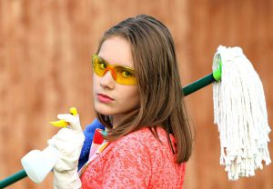 Girl with plastic gloves and a mop